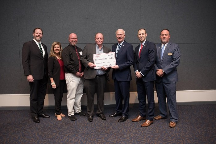 Officials from the city of Felsenthal received a grant from AEDC officials and Gov. Asa Hutchinson.