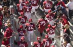 Arkansas players walk through fans on their way toward the field prior to a game against Vanderbilt on Saturday, Oct. 27, 2018, in Fayetteville.