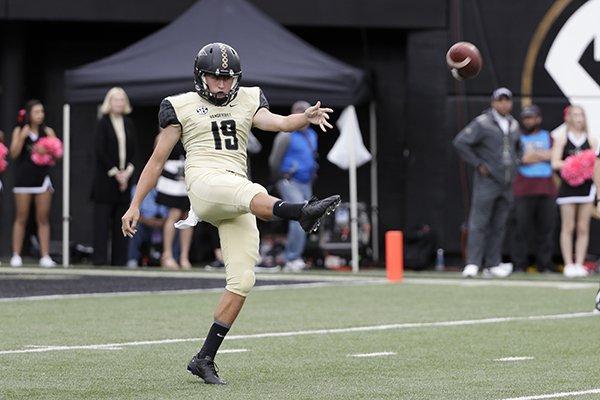 Vanderbilt punter Sam Loy kicks against Florida in the first half of an NCAA college football game Saturday, Oct. 1, 2016, in Nashville, Tenn. (AP Photo/Mark Humphrey)