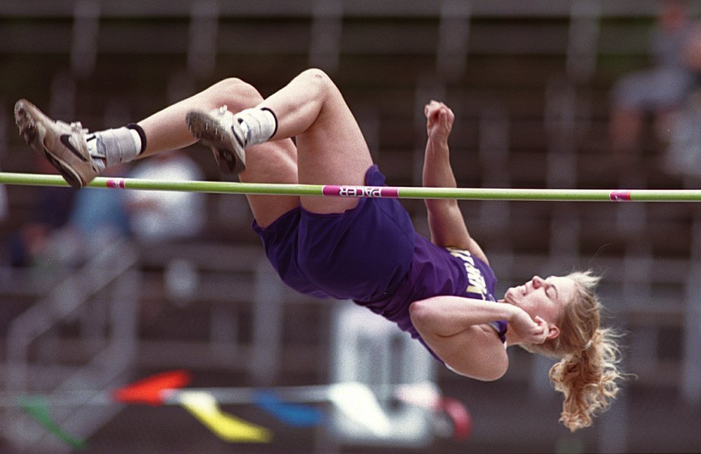 Ozark's Sarah Pfeifer clears the bar during competition at the State Track and Field Championships Thursday, May 9, 2002, at Hot Springs High School.
