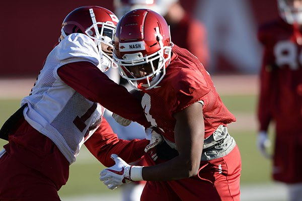 Arkansas receiver Shamar Nash (right) takes part in a drill Tuesday, March 5, 2019, during practice at the university practice facility on campus in Fayetteville.