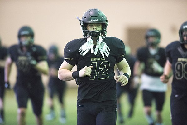 Bentonville High School linebacker Cole Joyce (42) runs through drills prior to the the spring football game, Thursday, May 24, 2018, at Tiger Stadium in Bentonville.