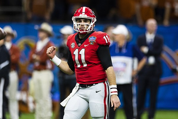 Georgia quarterback Jake Fromm (11) celebrates a touchdown during the Sugar Bowl NCAA college football game against Texas on Wednesday, Jan. 1, 2019 in New Orleans. (Ric Tapia via AP)