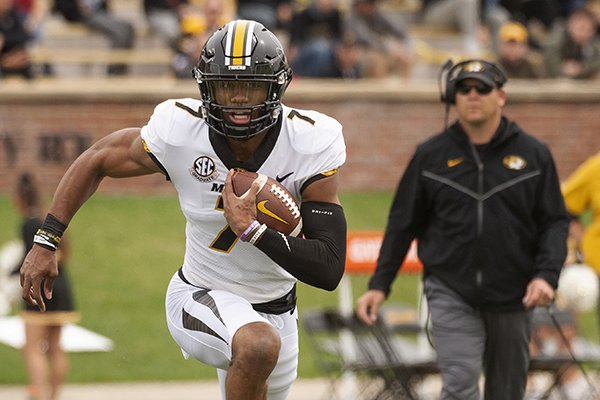 Missouri quarterback Kelly Bryant, left, scrambles for a gain in front of head coach Barry Odom, right, during an NCAA college football intrasquad spring game Saturday, April 13, 2019, in Columbia, Mo. (AP Photo/L.G. Patterson)