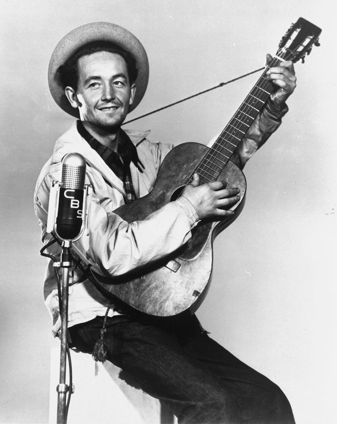 "Woody Guthrie wrote ""This Land Is Your Land"" in response to Irving Berlin's ""God Bless America."" (AP)"