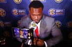 Arkansas linebacker De'Jon Harris speaks to reporters during the NCAA college football Southeastern Conference Media Days, Wednesday, July 17, 2019, in Hoover, Ala. (AP Photo/Butch Dill)