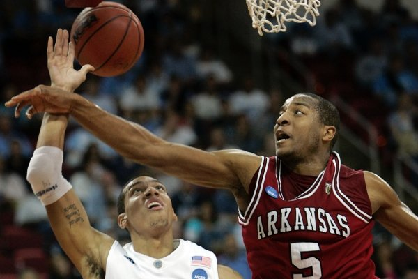 North Carolina's Danny Green (14) and Arkansas' Darian Townes (5) battle in the first half of a second-round NCAA East Regional basketball game in Raleigh, N.C., Sunday, March 23, 2008. (AP Photo/Mel Evans)