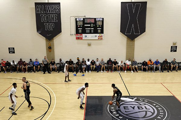 Basketball coaches watch a game during the Nike Peach Jam at Riverview Park in North Augusta, S.C., in this 2017 file photo. (AP Photo/Todd Bennett)