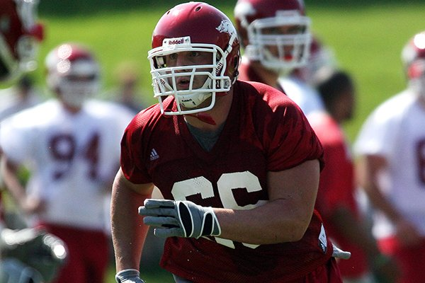 Arkansas offensive lineman Mitch Petrus goes through practice Friday, Aug. 7, 2009, in Fayetteville.