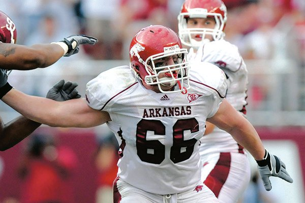 Arkansas offensive guard Mitch Petrus (66) blocks for quarterback Ryan Mallett during a game against Alabama on Saturday, Sept. 26, 2009, in Tuscaloosa, Ala. Petrus died of a heat stroke on Thursday, July 18, 2019, after working at a family farm in his hometown of Carlisle. He was 32.