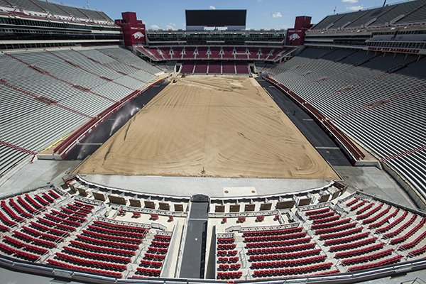 Donald W. Reynolds Razorback Stadium is shown Thursday, July 18, 2019, in Fayetteville. Crews are in their fourth month of a field installation at Arkansas' football home that will change the surface back to natural grass in time for the Razorbacks' Aug. 31 season opener against Portland State.