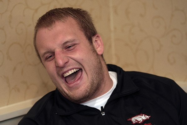 Arkansas offensive lineman Mitch Petrus laughs during a news conference Thursday, Dec. 31, 2009, in Memphis, Tenn.
