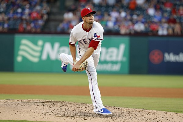 Texas Rangers starting pitcher Drew Smyly (33) works against the Cleveland Indians during a baseball game in Arlington, Texas, Tuesday, June 18, 2019. (AP Photo/Tony Gutierrez)