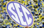SEC sign held up by a player after the Southeastern Conference Championship NCAA college football game against the Alabama Crimson Tide and the Georgia Bulldogs on Saturday, Dec. 1, 2018 in Atlanta. (Ric Tapia via AP)