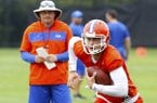 Florida quarterback Feleipe Franks (13) runs with the ball as head coach Dan Mullen watches during an NCAA college football practice in Gainesville, Fla., Friday, July 26, 2019. (Brad McClenny/The Gainesville Sun via AP)