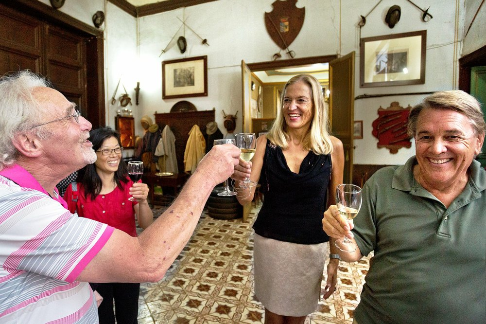 Countess Alwine Federico toasts tour group members in her home, Palazzo Conte Federico one of the oldest dwellings in Palermo, Sicily. (Photo by Dominic Arizona Bonuccelli via Rick Steves' Europe)