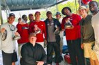 Cornerbacks coach Mark Smith, defensive tackles coach Kenny Ingram and other members of Arkansas' football staff pose following a fishing trip on the White River in late July. (Photo/Mark Smith, Twitter)