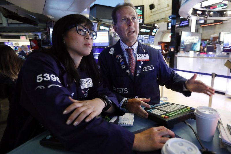 1620435f Specialists Erica Fredrickson, left, and Glenn Carell work on the floor of  the New York Stock Exchange, Tuesday, July 30, 2019. U.S. stocks moved  broadly ...