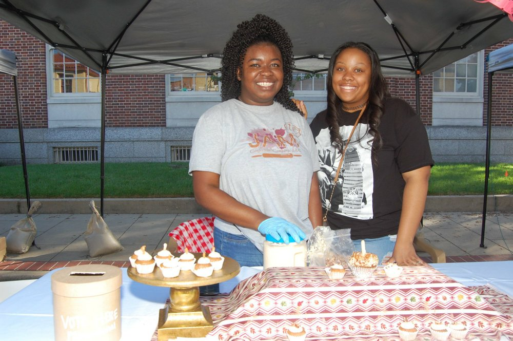 Professional baker De'Jeune Kinchen of Jam Confection Co., with Shirleta Lee of Forrest City, were competitors at the 2018 Cupcakes for Goodness Sake benefit for Carelink. This year's event takes place Oct. 12; deadline to enter is Sept. 20. Democrat-Gazette file photo/Helaine R. Williams