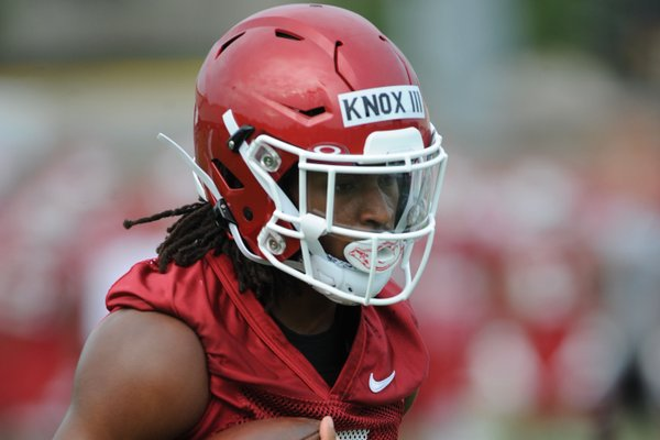 Arkansas receiver Trey Knox carries the ball Friday, Aug. 2, 2019, after making a catch during practice at the university practice field in Fayetteville. Visit nwad.com/photos to see more photographs from the practice.