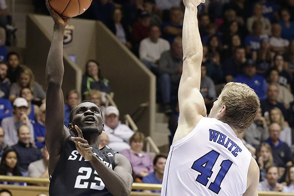Duke's Jack White (41) defends while Stetson's Abayomi Iyiola (23) shoots during the first half of an NCAA college basketball game in Durham, N.C., Saturday, Dec. 1, 2018. (AP Photo/Gerry Broome)