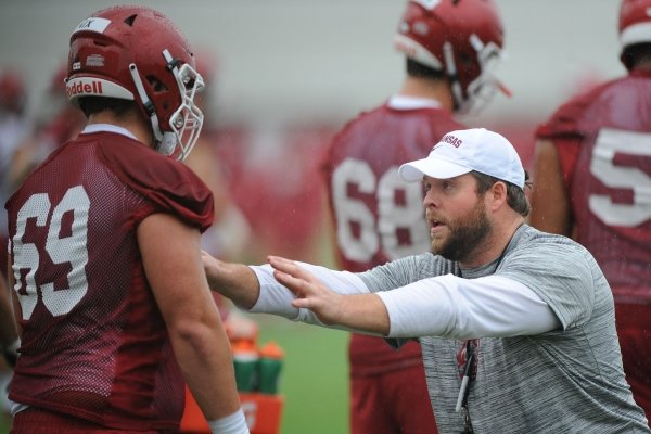 Arkansas assistant coach Dustin Fry works Saturday, Aug. 3, 2019, with offensive lineman Austin Nix during practice at the university practice field in Fayetteville. Visit nwad.com/photos to see more photographs from the practice.