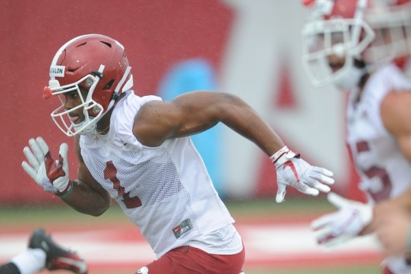Arkansas defensive back Jalen Catalon runs Saturday, Aug. 3, 2019, during practice at the university practice field in Fayetteville. Visit nwad.com/photos to see more photographs from the practice.