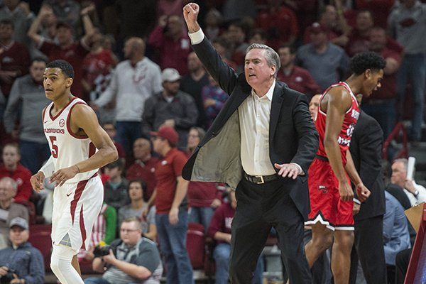 Western Kentucky coach Rick Stansbury motions from the sideline during a game against Arkansas on Saturday, Dec. 8, 2018, in Fayetteville.