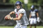 Quarterback Matt Corral passes during an Ole Miss practice in Oxford, Miss., Monday, Aug. 5, 2019. (Bruce Newman/Oxford Eagle via AP)