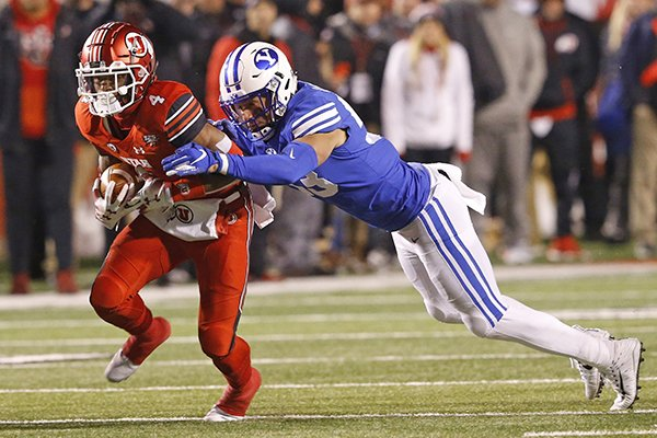 BYU linebacker Isaiah Kaufusi, right, tackles Utah running back TJ Green (4) in the first half during an NCAA college football game Saturday Nov. 24, 2018, in Salt Lake City. (AP Photo/Rick Bowmer)