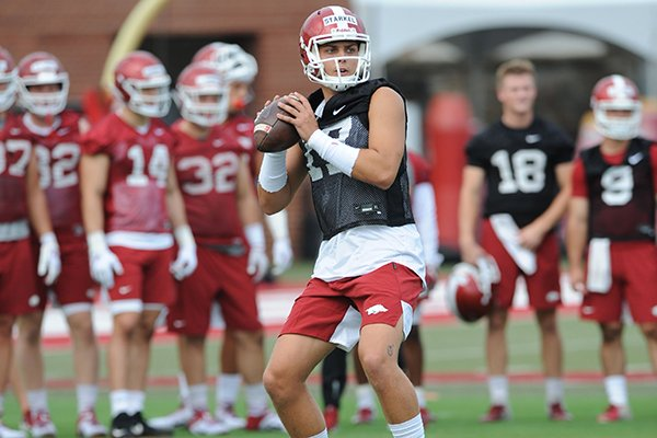 Arkansas quarterback Nick Starkel looks to pass Friday, Aug. 2, 2019, during practice at the university practice field in Fayetteville.