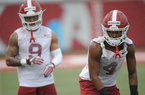 Arkansas defensive backs Jarques McClellion (4) and Greg Brooks Jr. (9) line up for a drill Saturday, Aug. 3, 2019, during practice at the university practice field in Fayetteville. Visit nwad.com/photos to see more photographs from the practice.