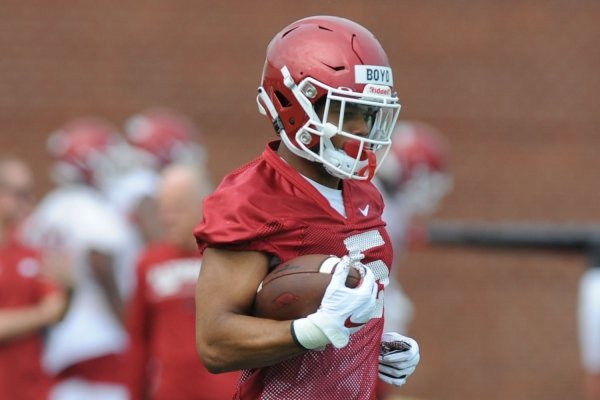 Arkansas running back Rakeem Boyd carries the ball Friday, Aug. 2, 2019, during practice at the university practice field in Fayetteville. Visit nwad.com/photos to see more photographs from the practice.
