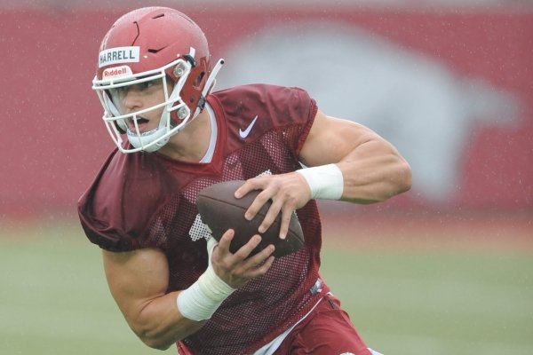 Arkansas tight end Chase Harrell makes a catch Saturday, Aug. 3, 2019, during practice at the university practice field in Fayetteville.
