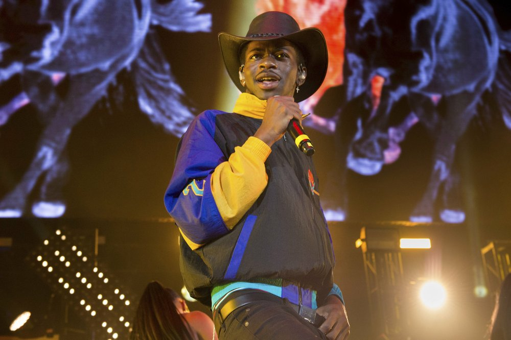 "Lil Nas X performs at HOT 97 Summer Jam 2019 in East Rutherford, N.J., in this file photo. The rapper's viral ""Old Town Road"" has broken the Billboard record set by Mariah Carey's ""One Sweet Day"" for most weeks at No.1. (Photo by Scott Roth via Invision/AP)"