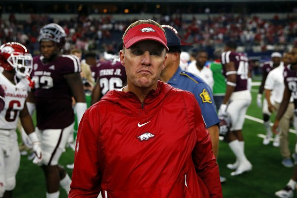 In this Sept. 29, 2018, file photo, Arkansas Razorbacks head coach Chad Morris walks off the field after a 24-17 loss to Texas A&M in an NCAA college football game in Arlington, Texas. (AP Photo/Roger Steinman, File)