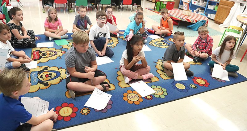 The Sentinel-Record/Richard Rasmussen LISTENING CLOSELY: Cutter Morning Star students in teacher Kachera Felts' homeroom class listen to instructions on the first day of the 2019-20 school year.