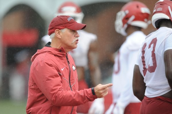 Arkansas assistant coach Steve Caldwell directs his players Saturday, Aug. 3, 2019, during practice at the university practice field in Fayetteville. Visit nwad.com/photos to see more photographs from the practice.