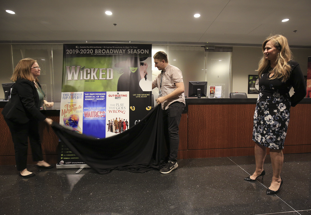 """Marketing Director Deana McCormack (right) discusses Celebrity Attractions' 2019-20 season at Little Rock's Robinson Center Performance Hall in March. The presenter warns patrons in its materials that """"Celebrity Attractions and Ticketmaster are the only official retail ticket outlets and the only way to guarantee that you are paying face value for legitimate tickets."""" (Democrat-Gazette file photo/STATON BREIDENTHAL)"""