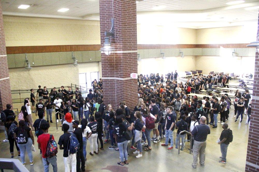 El Dorado High School students prepare for their first day of school chant.