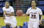 Arkansas-Little Rock guard Kyra Collier (23) and Little Rock forward Ronjanae DeGray (00) head down court against South Alabama in the first half of an NCAA college basketball game during the championship game of the Sun Belt Conference women's tournament in New Orleans, La. Saturday, March 16, 2019. Little Rock won 57-56 to advance to the NCAA Tournament. (AP Photo/Matthew Hinton)