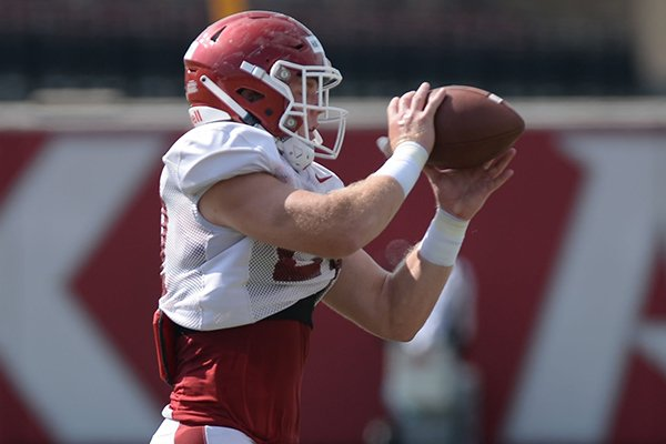Arkansas linebacker Hayden Henry catches a ball Tuesday, Aug. 13, 2019, during practice at the university practice facility in Fayetteville.