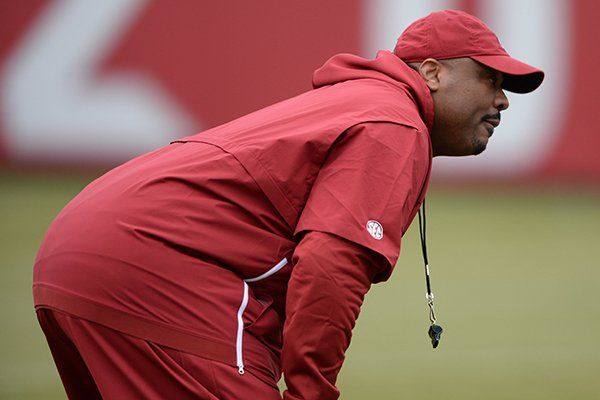 Arkansas assistant coach Kenny Ingram watches Friday, March 1, 2019, during practice at the university practice facility in Fayetteville.