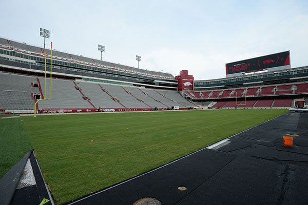 Work continues Wednesday, Aug. 7, 2019, to install a turf playing surface at Razorback Stadium in Fayetteville.