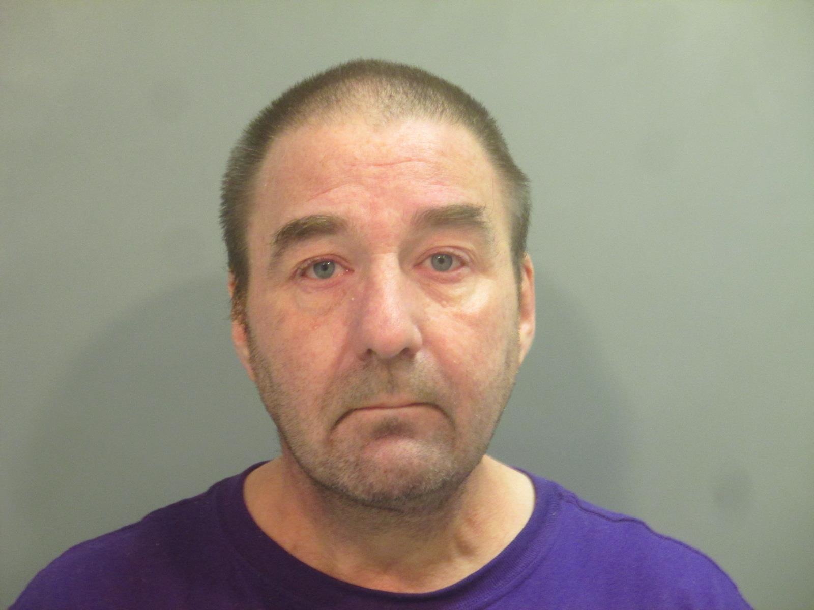 VA arrests former pathologist accused of working impaired
