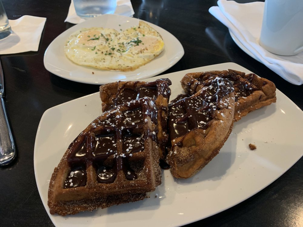 A Nutella cream sauce tops the Churro Waffles at brunch at Petit & Keet. Arkansas Democrat-Gazette/Eric E. Harrison