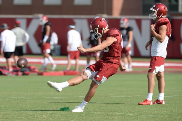Arkansas punter Matthew Phillips kicks Tuesday, Aug. 20, 2019, during practice at the university's practice facility in Fayetteville. Visit nwadg.com/photos to see more photographs from the practice.