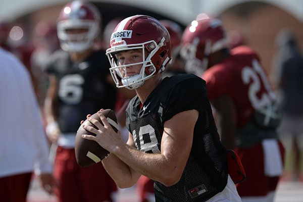 Arkansas quarterback Jack Lindsey prepares to throw the ball Tuesday, Aug. 20, 2019, during practice at the university's practice facility in Fayetteville.