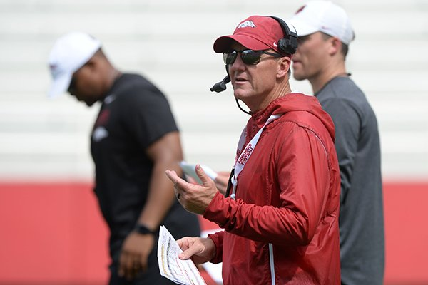 Arkansas coach Chad Morris watches Saturday, Aug. 24, 2019, during practice in Razorback Stadium in Fayetteville.