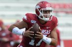 Arkansas quarterback Nick Starkel carries the ball Saturday, Aug. 24, 2019, during practice in Razorback Stadium in Fayetteville.